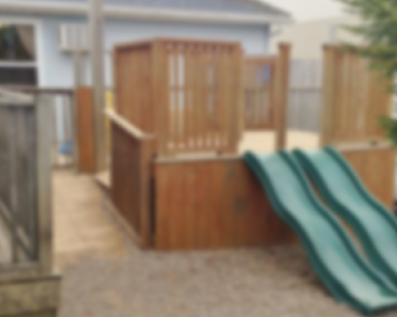 Blurred background image of the playground at Kids R Kids